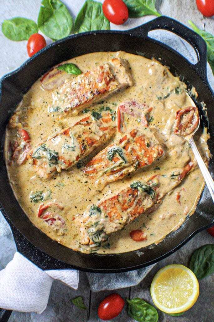 Creamy Garlic Tuscan Salmon in cast iron skillet