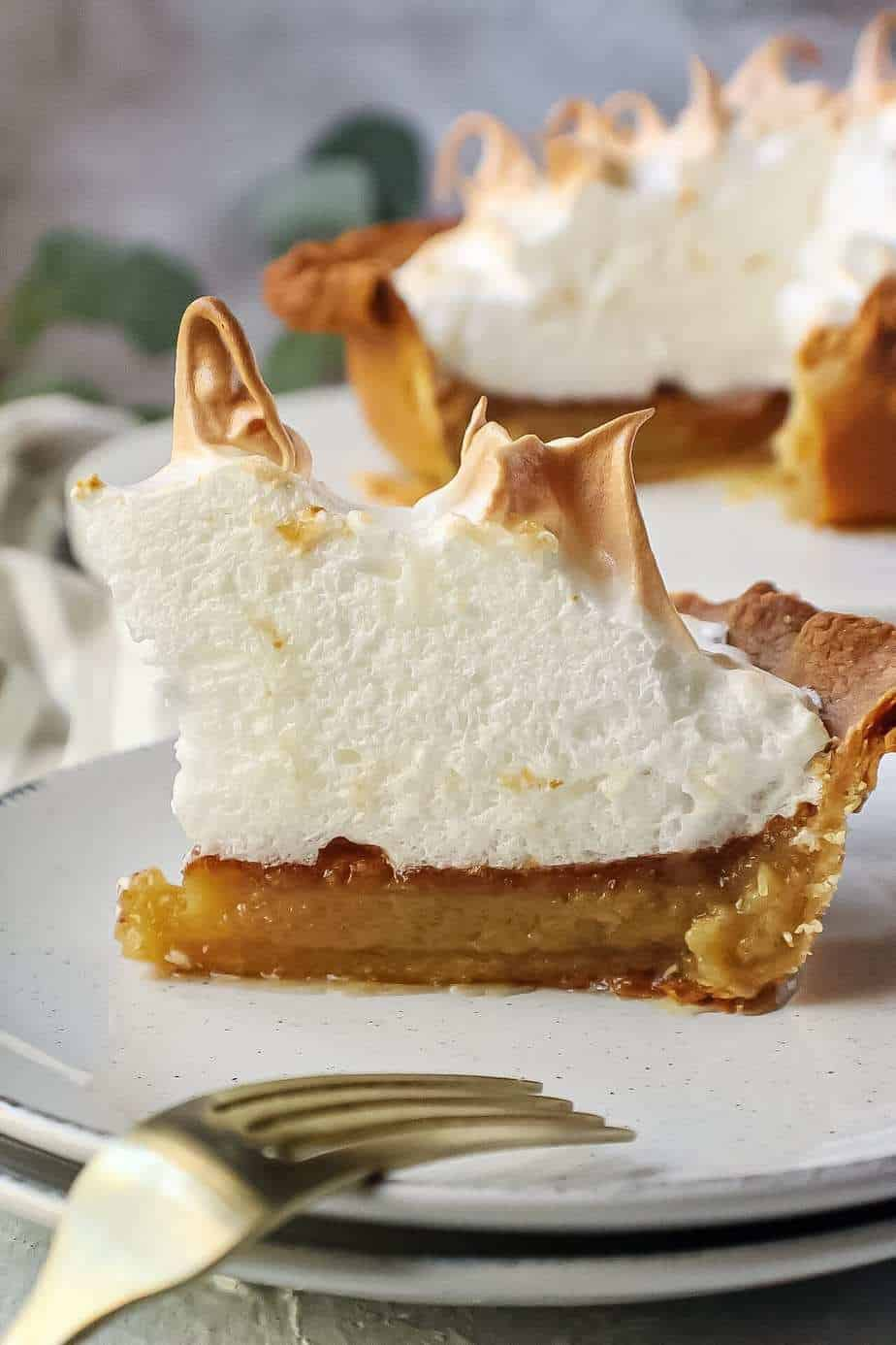 maple chess pie slice on white plate with fork