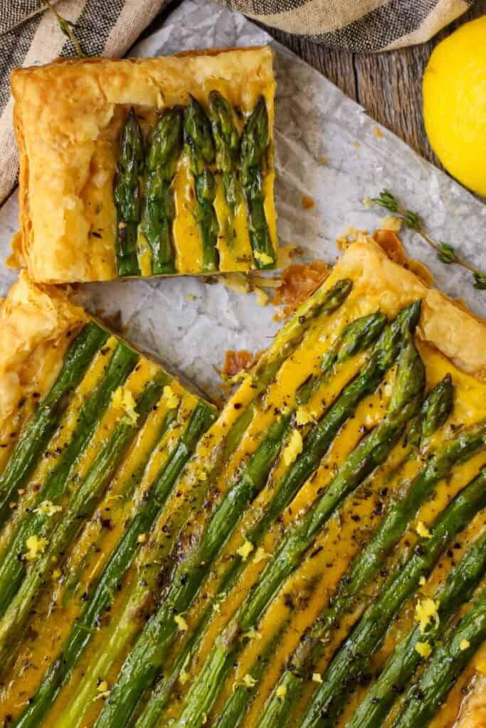 close up of asparagus tart on parchemnt paper.