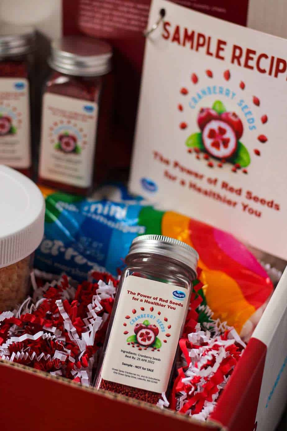 overhead shot of Ocean Spray Cranberry Seeds in box with recipe cards and package of marshmallows in the background.