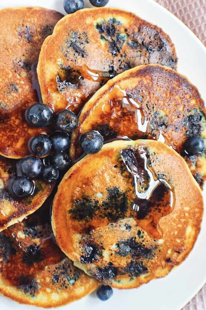 close up overhead shot of almond flour pancakes with fresh blueberries