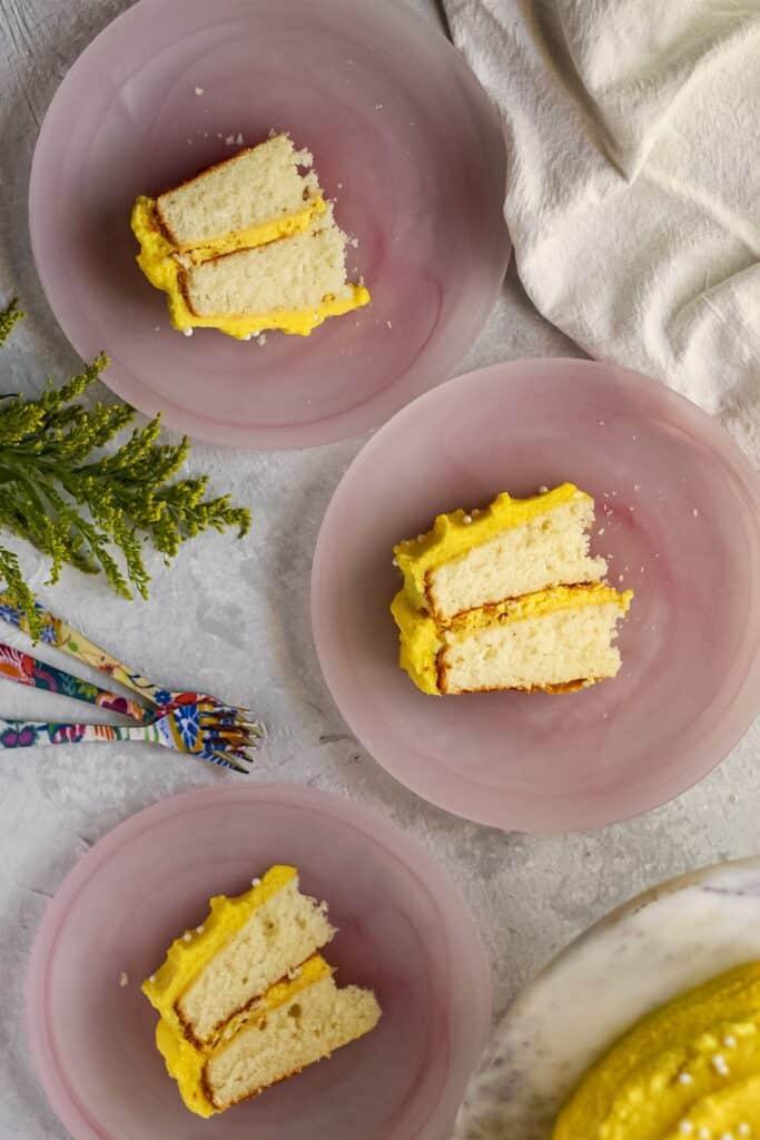 overhead shot of almond cake with lemon buttercream slices