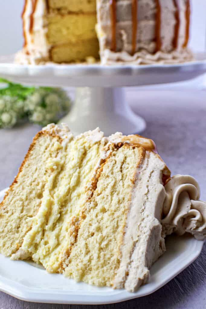 close up of caramel cheesecake layer cake