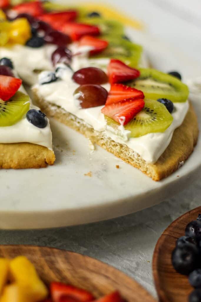 close up of sliced gluten-free fruit pizza