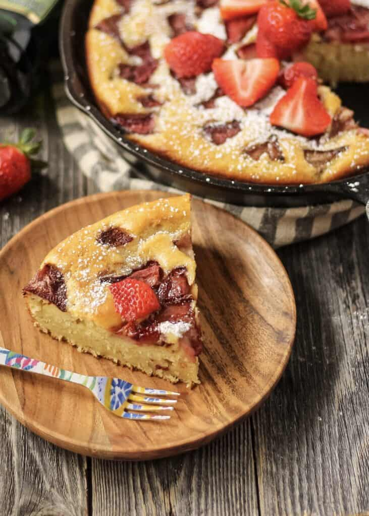 close up of slice of roasted strawberry olive oil skillet cake