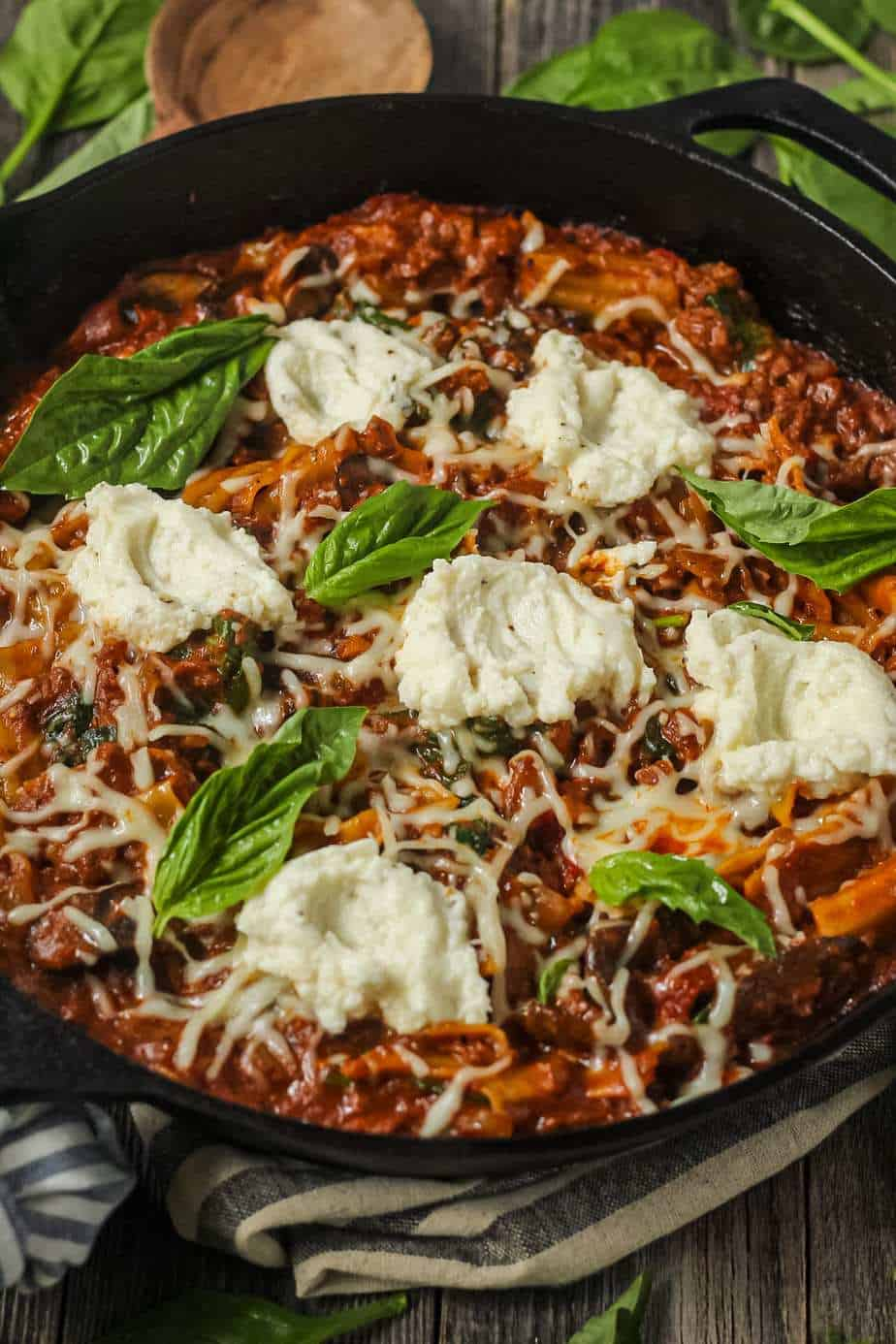 side angle shot of skillet lasagna in cast iron skillet.