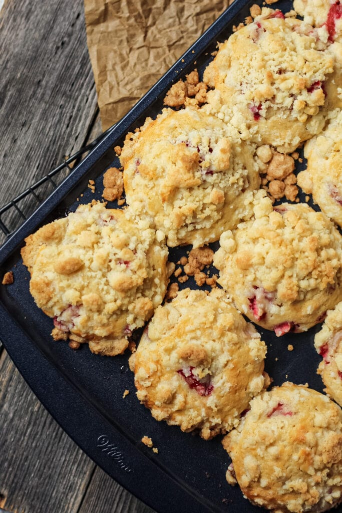 overhead shot of strawberry crumble muffins in muffin pan