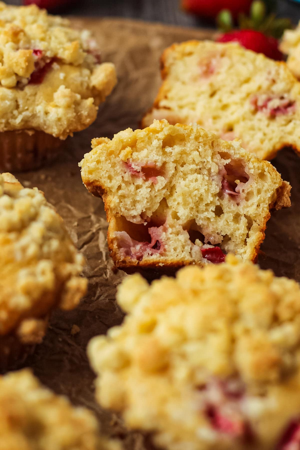 overhead shot of strawberry crumble muffins on parchment paper