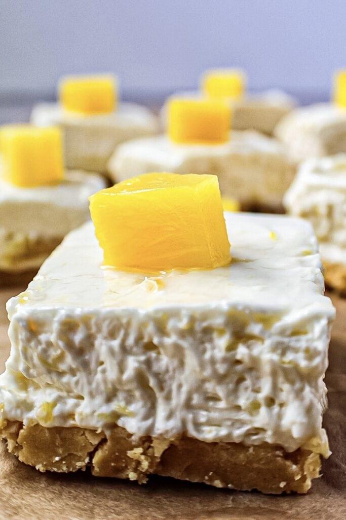 close up shot of pineapple cheesecake bars