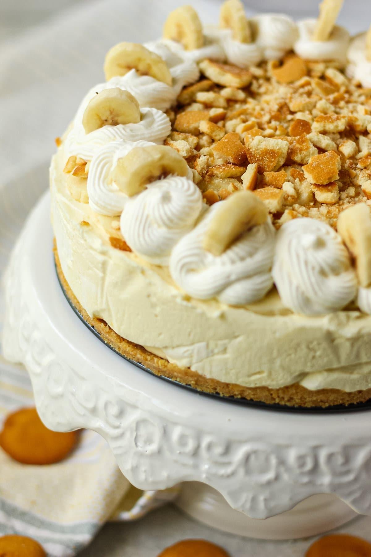 close up shot of banana pudding icebox pie on white cake stand