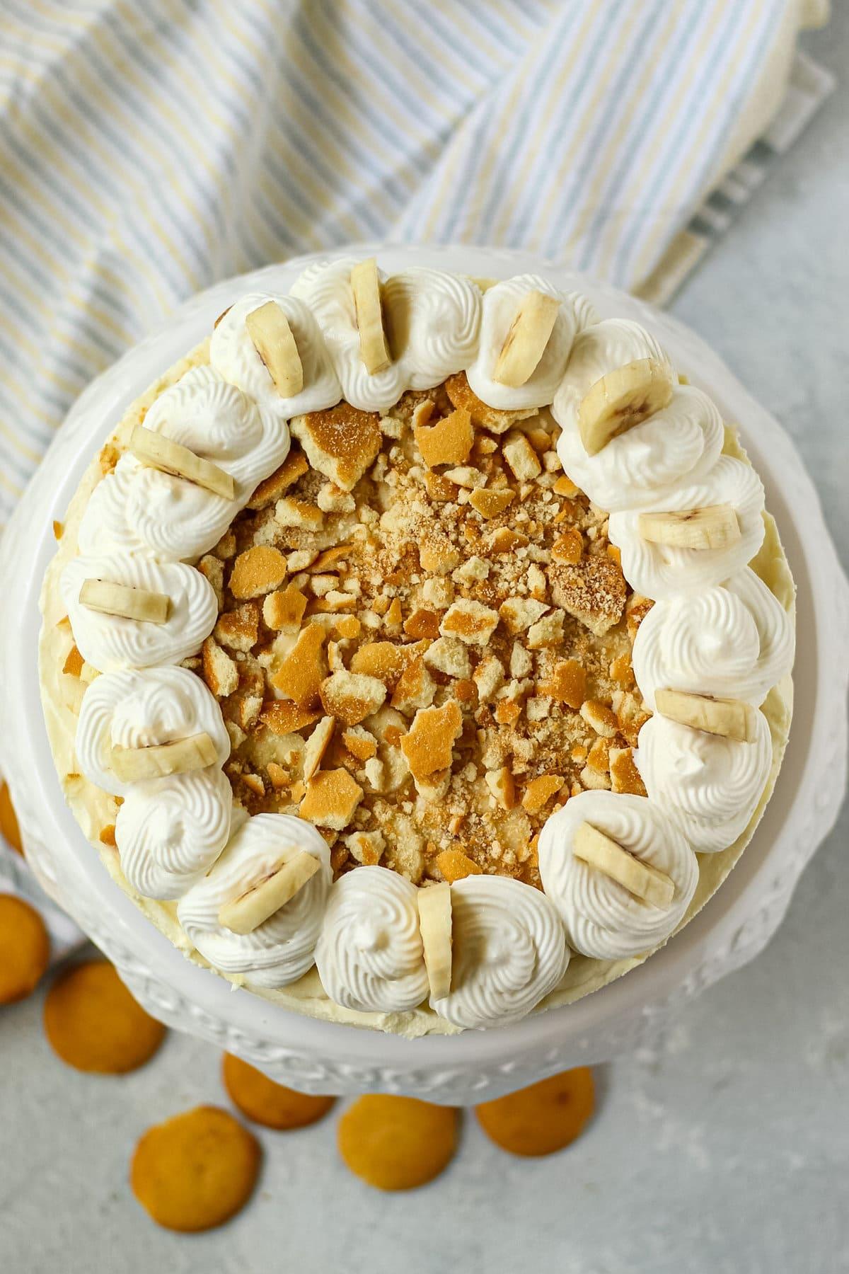 overhead shot of banana pudding icebox pie on white cake stand