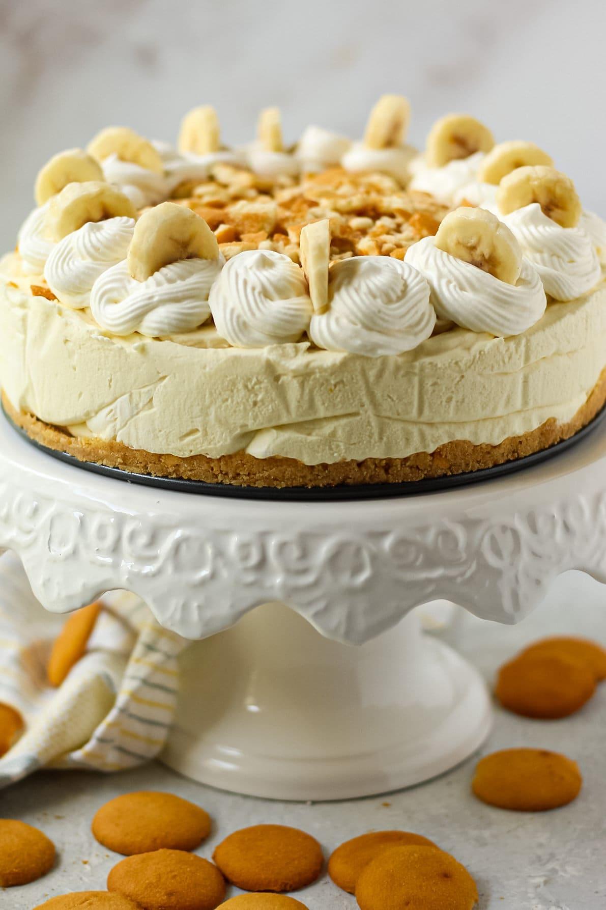 side angle shot of banana pudding icebox pie on white cake stand