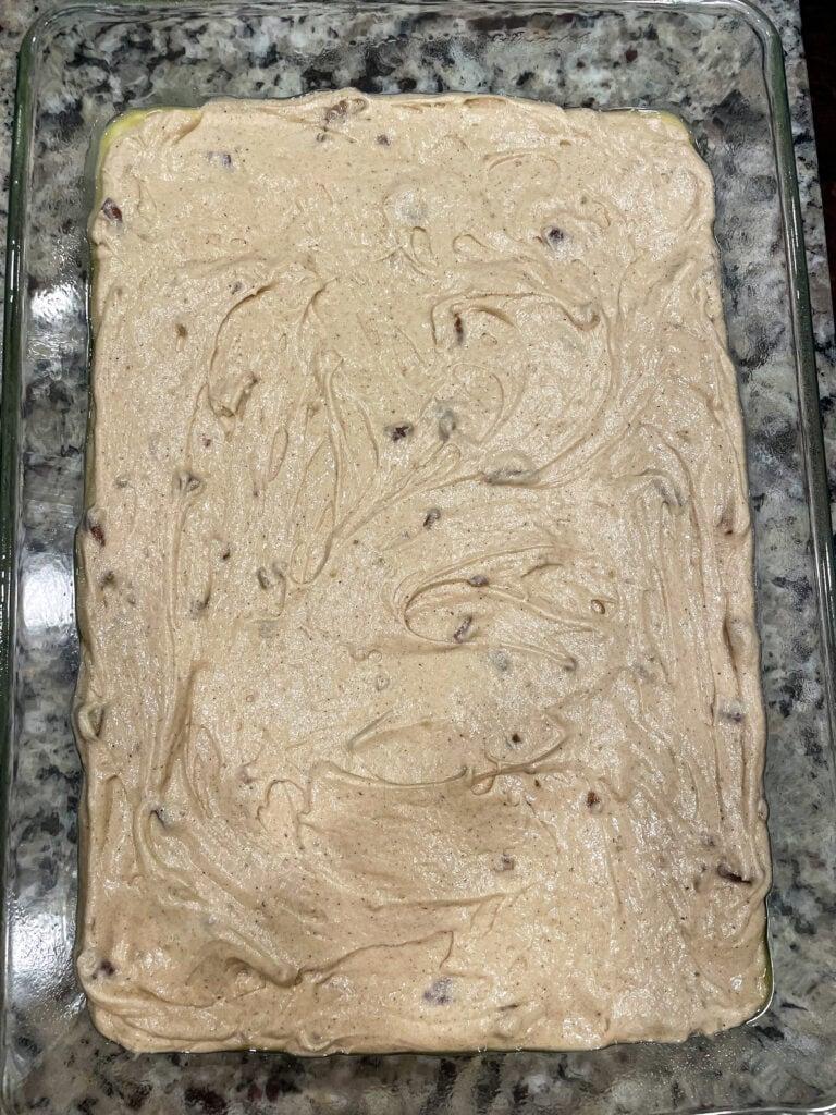overhead shot of praline cake batter in glass baking dish.