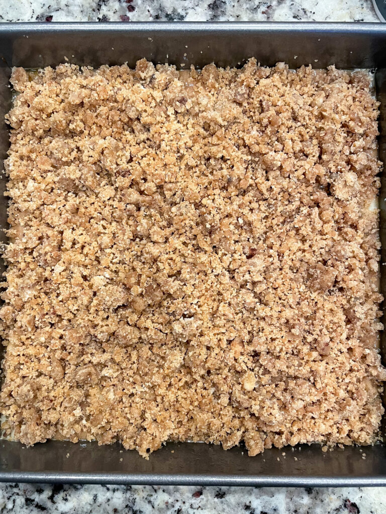 spiced apple crumb cake batter in baking pan ready for the oven.