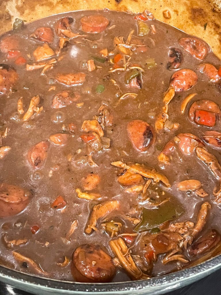 close up shot of authentic gumbo after simmering with chicken and sausage