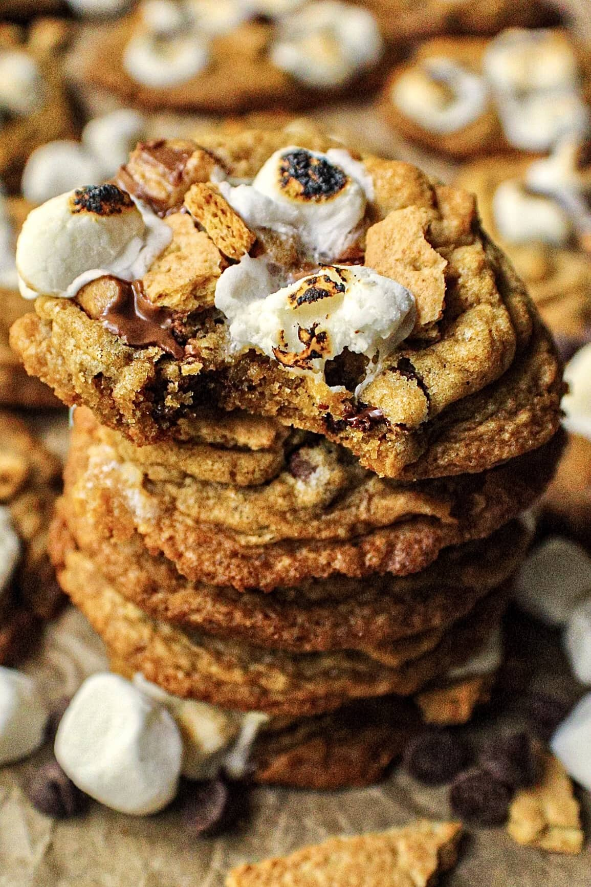 overhead shot of a stack of peanut butter cup s',ores cookies on parchment paper.